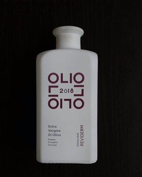 Logodirektdruck Tampondruck auf Flasche mit Mattlackierung weiss